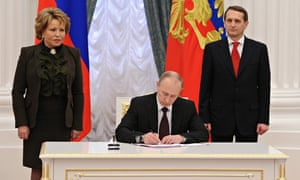 Russia's president Vladimir Putin signs law on ratification of a treaty making Crimea part of Russia