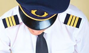 Airline pilot wearing a hat
