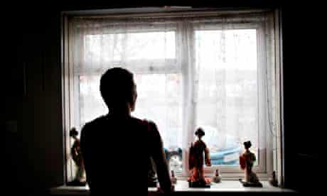 mental health crisis man at window in home