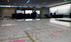Search-and-rescue officers from the Australian Maritime Safety Authority coordinate the search for Malaysia Airlines flight MH370 from the Rescue Coordination Centre in Canberra, Australia.