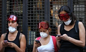 Turkish women using mobile phones at a protest against  police violence