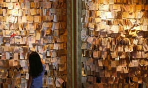 A girl reads some of the messages of hope and support for the passengers of the missing Malaysia Airlines MH370 at a mall outside Kuala Lumpur.