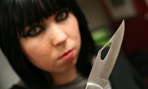 Female gang member with knife
