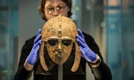 Sutton Hoo helmet being placed on display