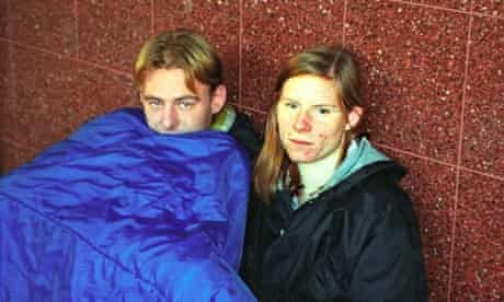 Young homeless couple on the street