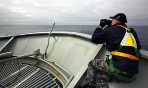 Able Seaman Kurt Jackson keeps watch on the forecastle of the Australian Navy ship, the HMAS Success, in a search area for missing Malaysian Airlines Flight MH370.