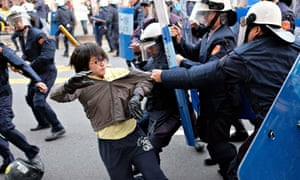 Protesters scuffle with police