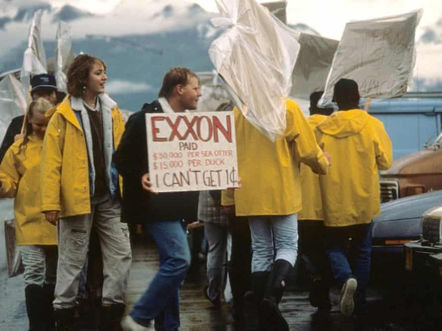 Valdez based seafood processors picket Exxon's Headquarters protesting a shortage of work due to the Exxon Valdez oil spill (wide shot) , Valdez, 24 July 1989.