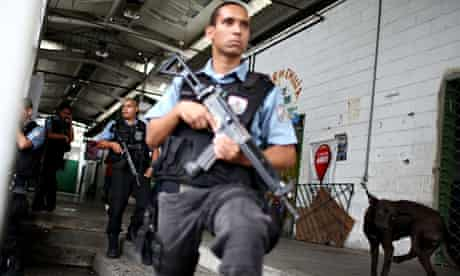 Military police officers keep watch in one of Rio's favelas.