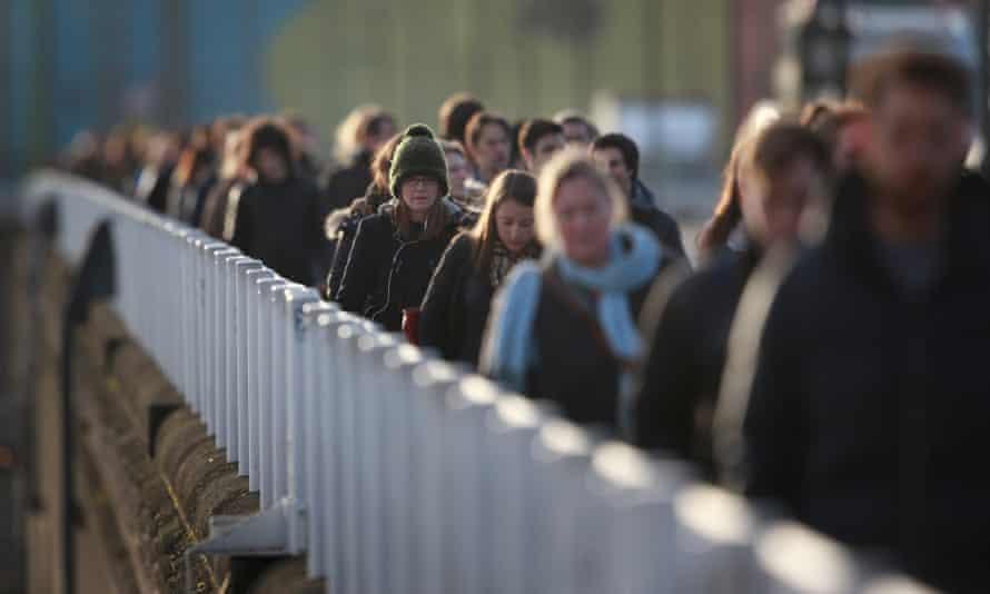 Commuters cross Waterloo Bridge in London.