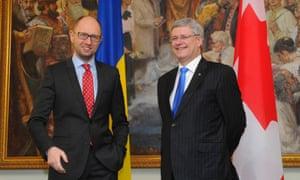Ukrainian prime minister Arseniy Yatsenyuk with Canadian prime minister Stephen Harper in Kiev on Saturday.
