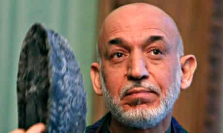 Afghanistan's President Hamid Karzai speaks during a joint news conference with Pakistan's Prime Min