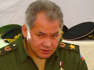 Russian defence minister Sergei Shoigu meets with Crimean officials at a military base in Sevastopol.