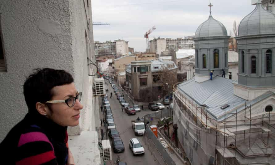 Artist Daniela Turcu looks out over Bucharest: 'After one of last year's bigger earthquakes I got scared.' Photograph: Kit Gillet