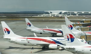 Malaysia Airlines continues service last week as planes prepare for passengers to board at Kuala Lumpur Airport where flight MH370 departed.