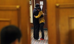 Relatives of passengers of the missing Malaysia Airlines flight MH370 embrace each other after learning of news from Kuala Lumpur, at a hotel in Beijing, China.