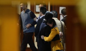 Grieving Chinese relatives of passengers on the missing Malaysia Airlines flight MH370 react after being told of their deaths at the Lido hotel in Beijing.