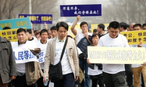 Relatives of flight MH370 passengers march to the Malaysian embassy in Beijing – a rare sight in a country that is strict on public protests.