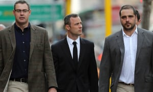 Oscar Pistorius arrives with relatives at the high court in Pretoria, South Africa, Tuesday, March 25, 2014.