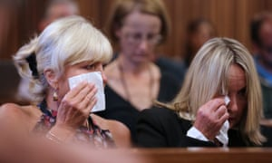 Reeva Steenkamp's mother June (R) and her friend Jenny Strydom react as CCTV footage is shown during Oscar Pistorius' trial for the murder of Reeva Steenkamp.