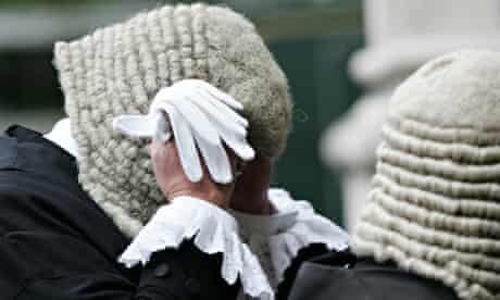 A Judge adjusts his wig