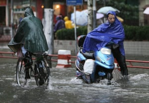 Shanghai residents struggle through flooded roads as a typhoon bears down on the city