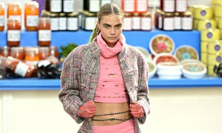 Cara Delevingne walks the runway at Lagerfeld's supermarket Chanel show