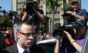 Oscar Pistorius leaves the high court in Pretoria, South Africa. The court will resume on Friday, when Pistorius could give evidence in his defence.