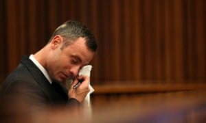 Oscar Pistorius reacts in the dock during evidence on mobile phone text messages between him and Reeva Steenkamp.