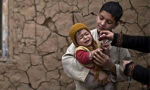 A children receives a polio vaccine in Islamabad
