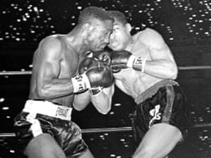 Davey Moore (left), defending featherweight champ, and Sugar Ramos trade punches in Los Angeles, 21 March 1963