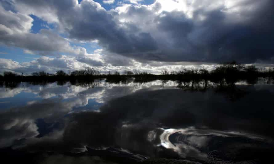 Flood water surrounds the flooded and largely evacuated village of Moorland on the Somerset Levels