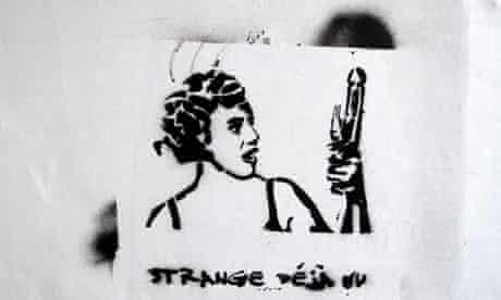 Graffiti of a woman holding a vibrator with text Strange Deja-Vu