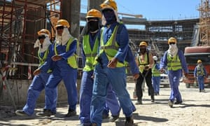 Foreign laborers work in Doha, Qatar