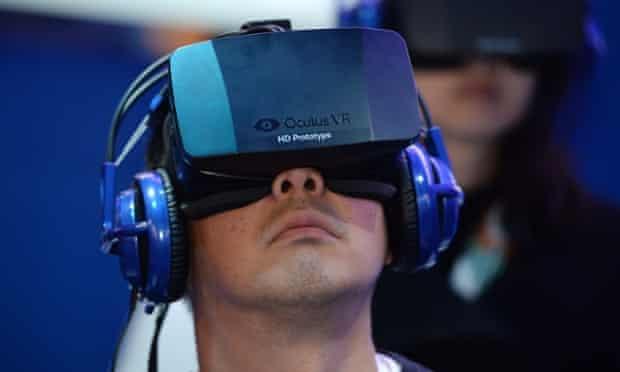 A CES attendee wears an Oculus Rift headset.