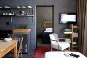Homes - small spaces: interior of room with dark walls and wooden furniture