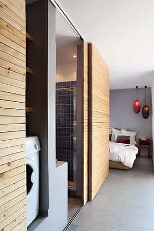 Homes - small spaces: interior of house with sliding wooden panels and grey floor
