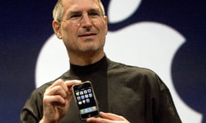 Steve Jobs holding the original iPhone at its introduction in January 2007: he had threatened to fire the engineers working on the original project.