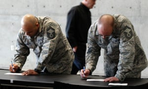 US air force personnel fill out applications at a job fair.