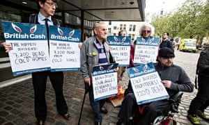 Campaigners against high fuel prices with placards protest at a British Gas shareholder meeting