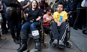Protesters demonstrate against IT company Atos's involvement in tests for incapacity benefits