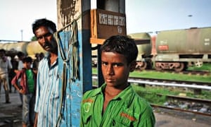 Muntasin, 10, with his uncle Mohammed Hasib, at Katihar station in Bihar state, India