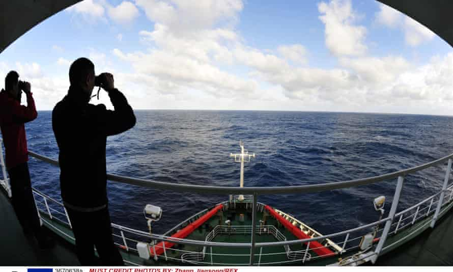 Crew members of Chinese icebreaker Xuelong search for missing Malaysia Airlines flight MH370 in the southern Indian Ocean Photograph: Zhang Jiansong/REX