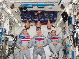 Expedition 38 crew members pose for an in-flight crew portrait in the Kibo laboratory of the International Space Station.