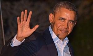 US President Barack Obama waves