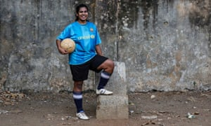 Rachel Blaekly, an 18-year-old student, poses during a football practice session at a playground in Mumbai. Rachel said that she wants stricter laws for women security from the new government after the elections.