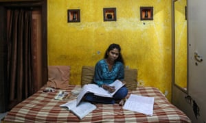 Riteesha Tambe, an 18-year-old college student, poses inside her house in Mumbai. Riteesha said that she wants a better higher education system from the new government after the elections.