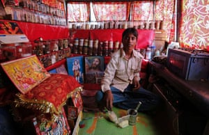 Shamsher Singh, a 19-year-old worker, poses inside a mobile traditional Indian ayurvedic medicine shop in Mumbai. Shamsher said that he wants more job opportunities for the youth from the new government after the elections.
