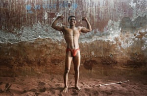Deepak Mane, a 19-year-old wrestler, poses inside a traditional Indian wrestling centre called Akhaara in Mumbai. Deepak said that he wants better internal security and stricter anti-terrorism laws from the new government after the elections.