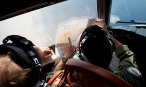 An Australian air force crew in the cockpit of an Orion plane searching for flight MH370 in the Indian Ocean.